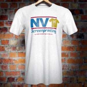 NV Screenprinting logo shirt in front of a brick wall.